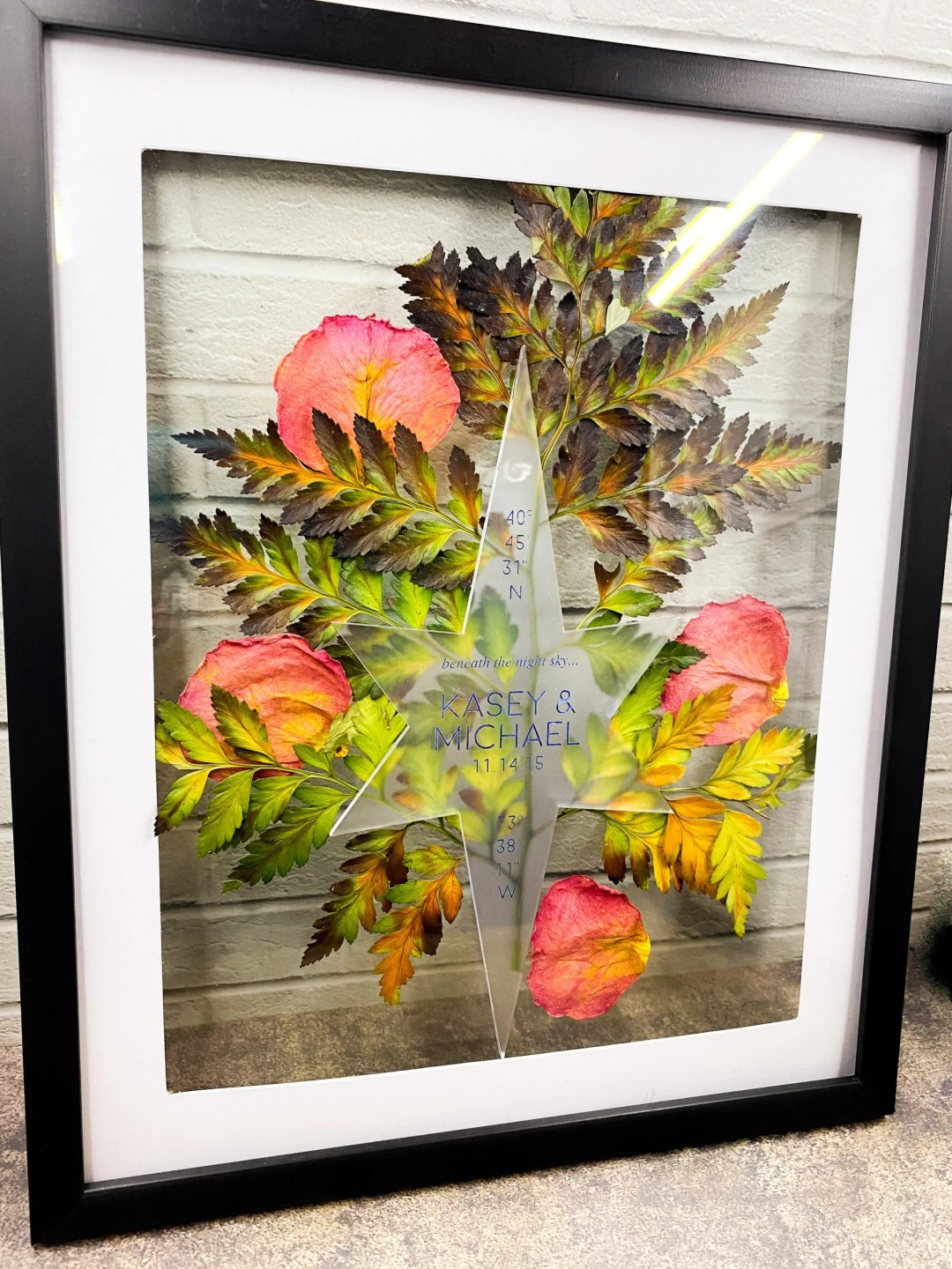 pressed rose petals and fern surround star shape art piece in home decor