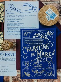 navy blue wedding invitation with gold foil imprinting - features vintage inspired design with ornate embellishments and typography