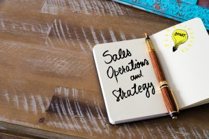 Notebook with Sales Operations and Strategy written in it.