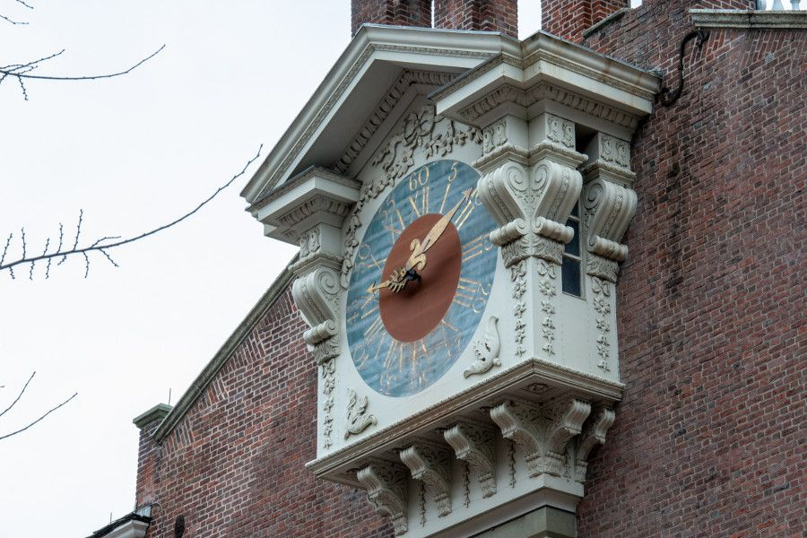 A clock in the side of a historic building in Philadelphia.