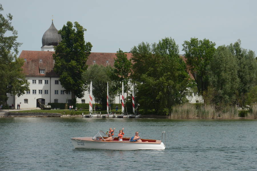 A family relaxing in boat on the Chiemsee.