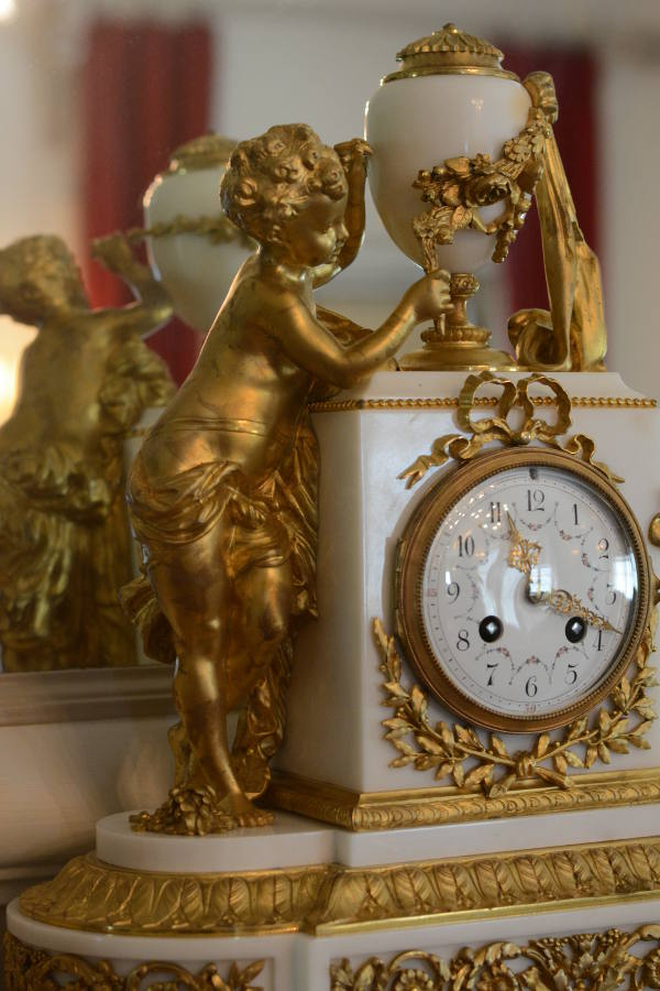 An antique gilded clock at Nemours Mansion.