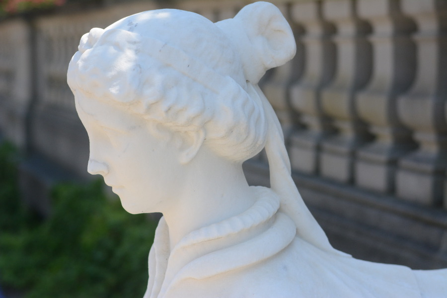 A stone sculpture welcomes guests to Nemours Mansion.