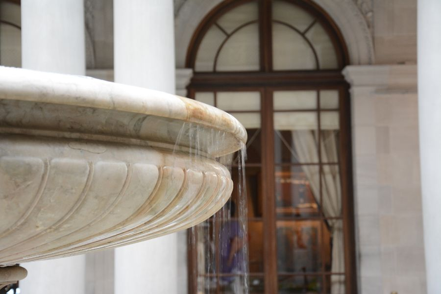 The water fountain in the middle of the Frick Collection's Garden Court.