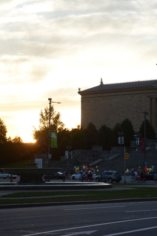 Cai Guo-Qiang: Fireflies pedicabs glide past the Philadelphia Museum of Art.