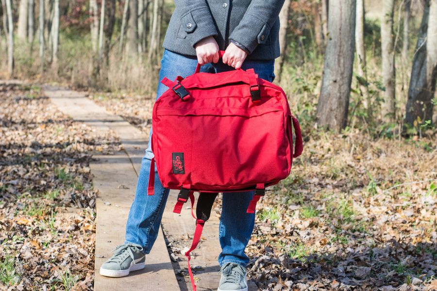 Showing off the side handle of the CabinZero 36L Classic Ultra-Lightweight backpack.