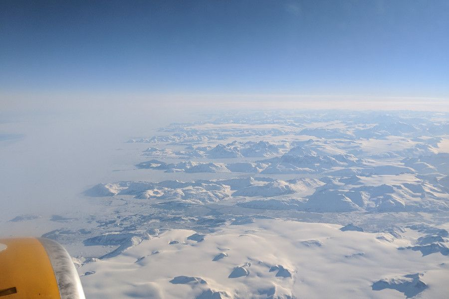 View of Greenland from the airplane window flying Icelandair.