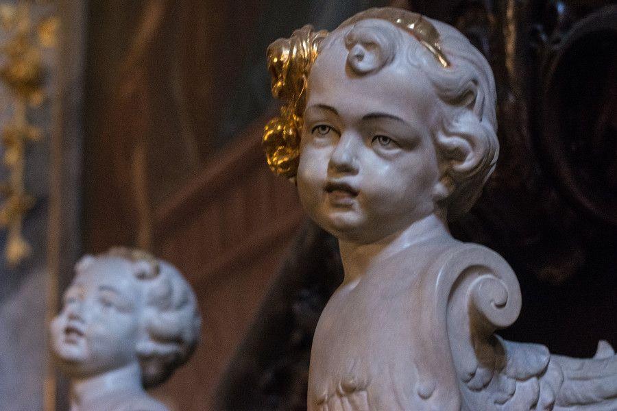An angel head sculpture inside the Asamkirche in Munich, Germany.