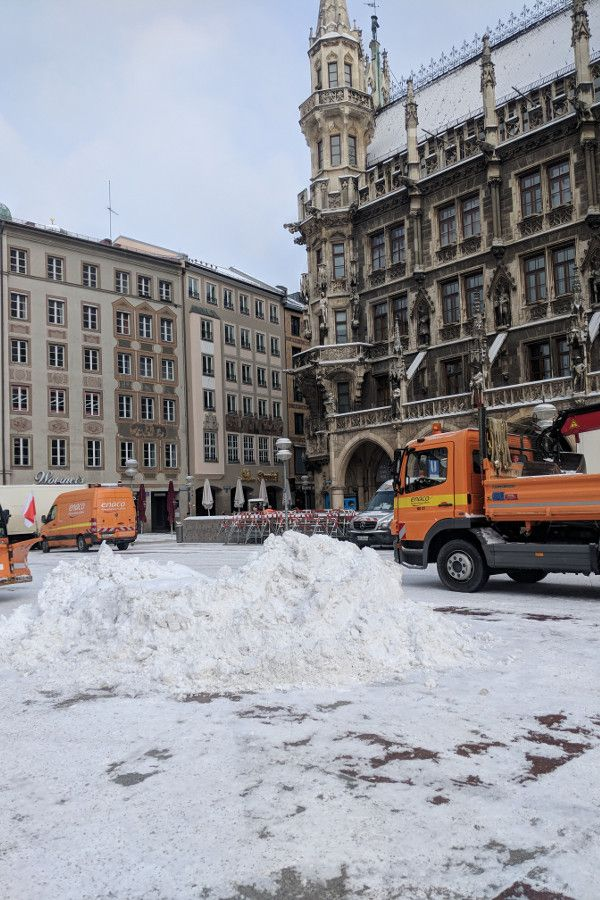 Trucks cleaning up the snow in Marienplatz, Munich, Germany.