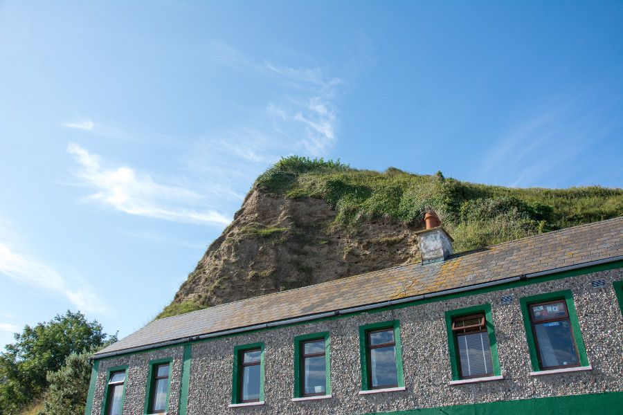 A hill overlooking a building in Howth.