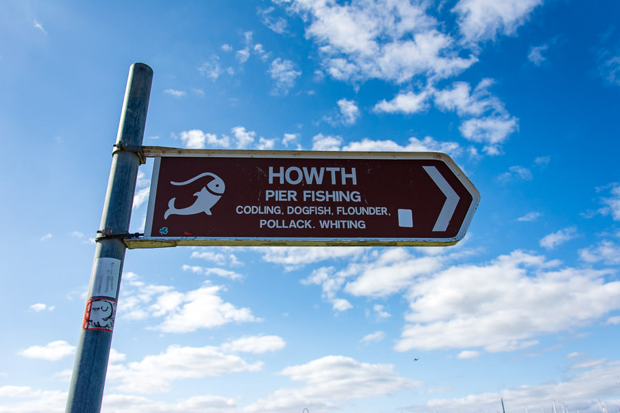 A sign points out the direction of Howth Harbour.