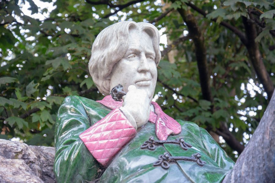 Oscar Wilde statue close up in Merrion Square, Dublin, Ireland.