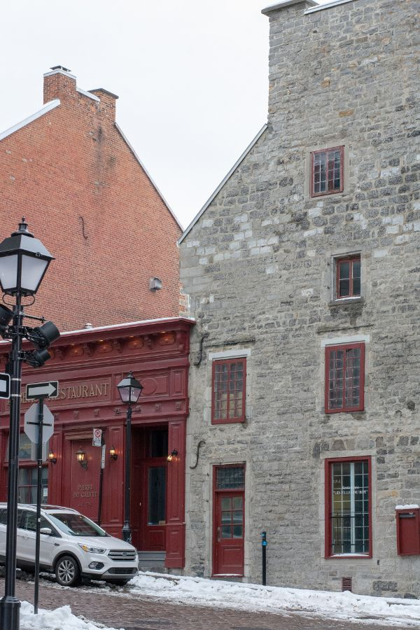 Shops line cobble stone streets in historic Old Montreal.
