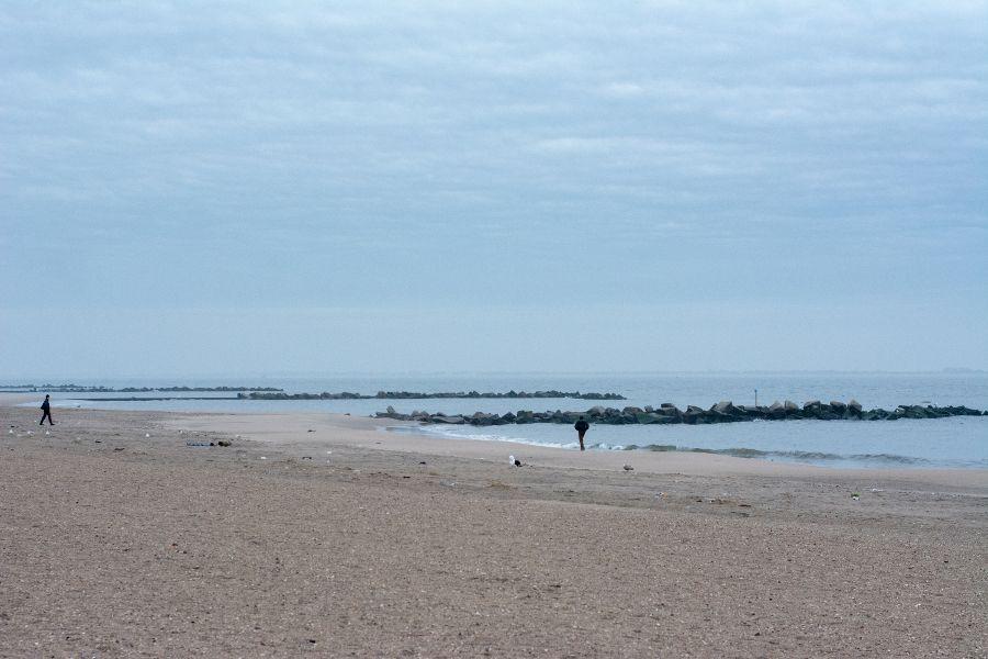 The empty Coney Island beach in winter.