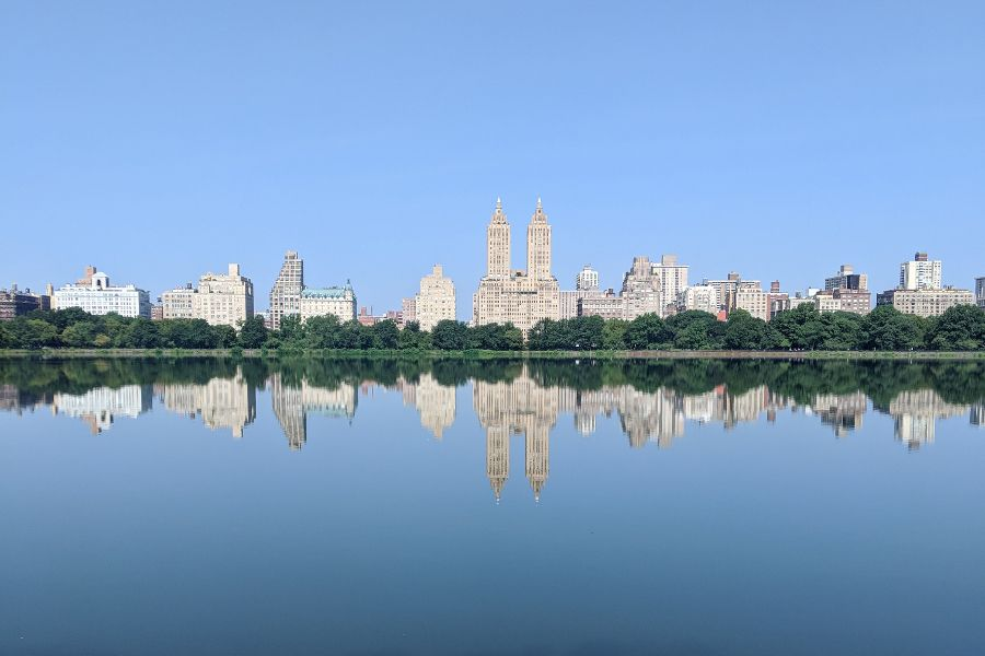 The New York City skyline and the Central Park Reservoir seen from the Upper East Side.