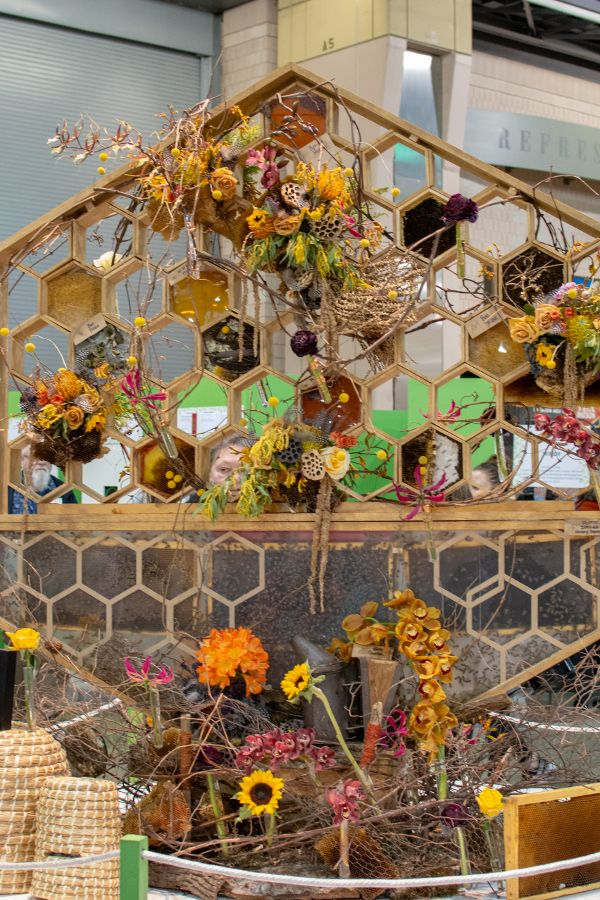 A ornamental honey comb full of 10,000 Italian honeybees at the Philadelphia Flower Show 2019.
