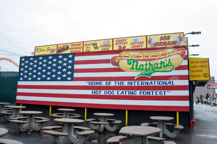 The American flag billboard at Nathan's Famous the original Coney Island shop.