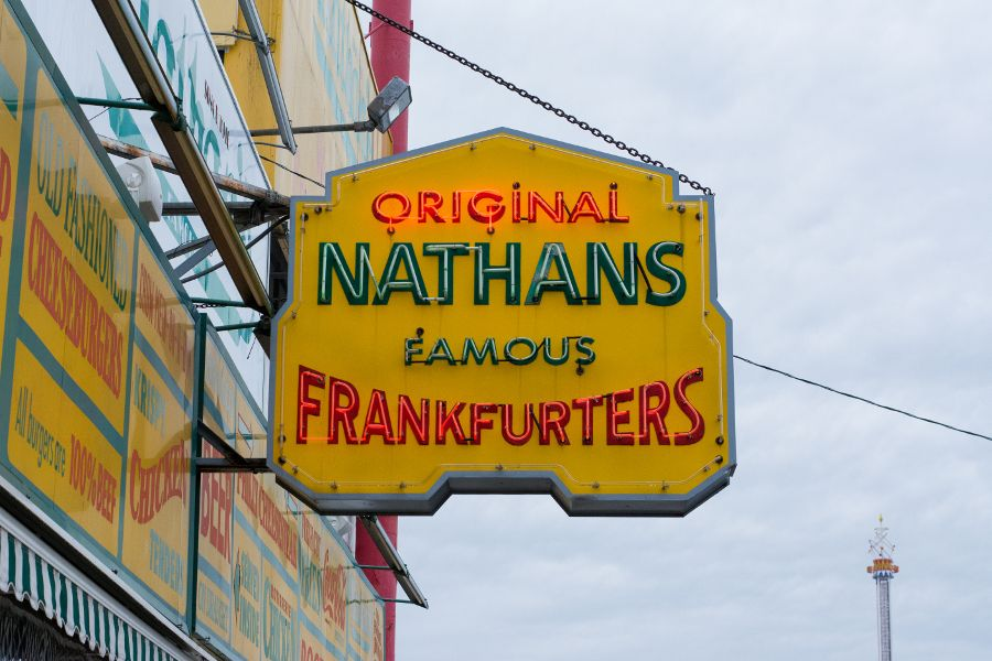 The Nathan's Famous neon light sign outside the original Coney Island shop.