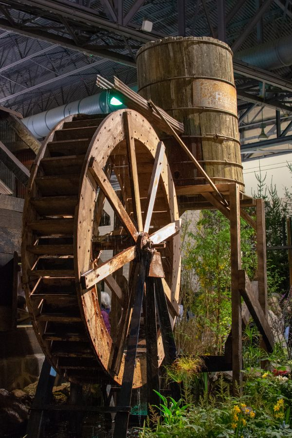 A water wheel turns at the Philadelphia Flower Show 2019.