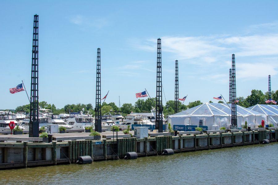 American flags line the walkway along a marina at the Washington waterfront.