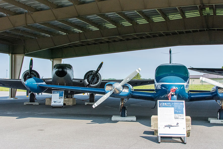 A C-45G Expeditor and a U-3a Blue Canoe aircraft at AMC Museum.