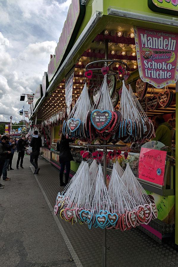 Lebkuchenherzen hang at a sweet stand at Munich Frühlingsfest.