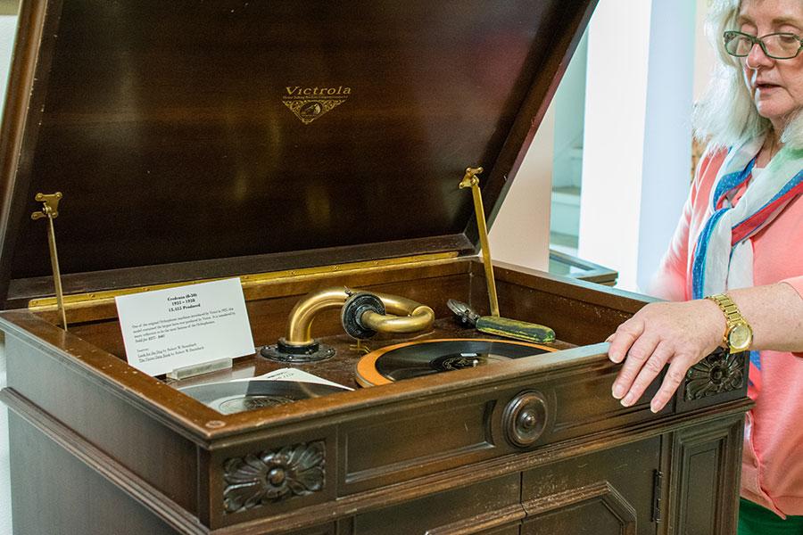 Examining a Victrola at the Johnson Victrola Museum.