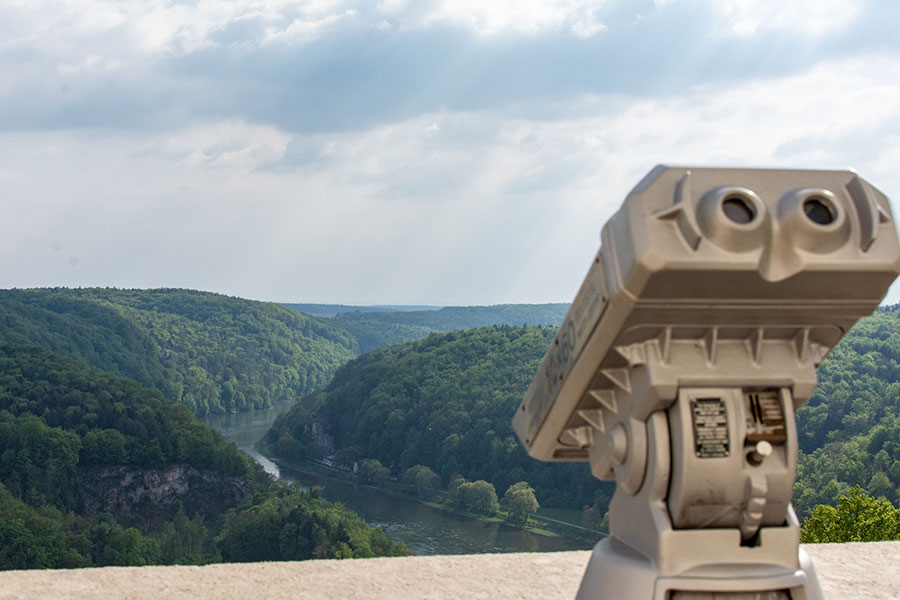 Binoculars are available for a better view over the Danube River Valley from the top of the Liberation Hall Kelheim.
