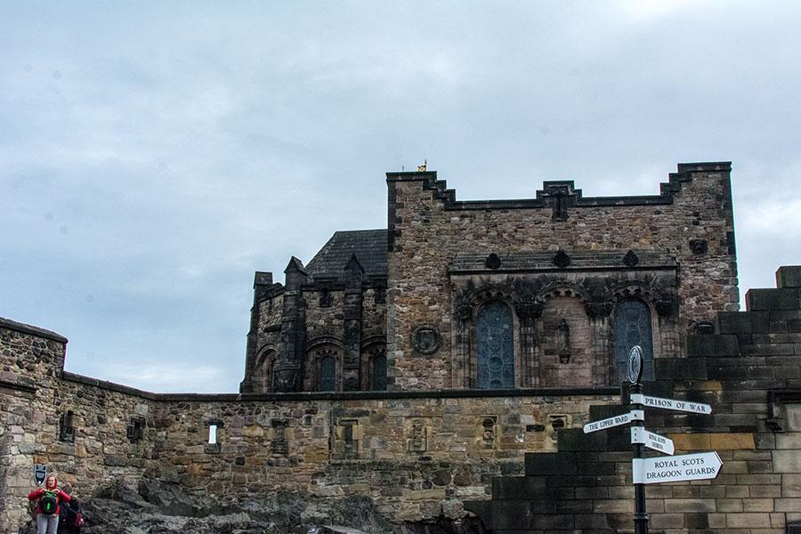 A signpost with Edinburgh Castle.