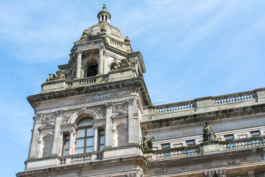 Looking up at the corner of the Glasgow City Chambers building.
