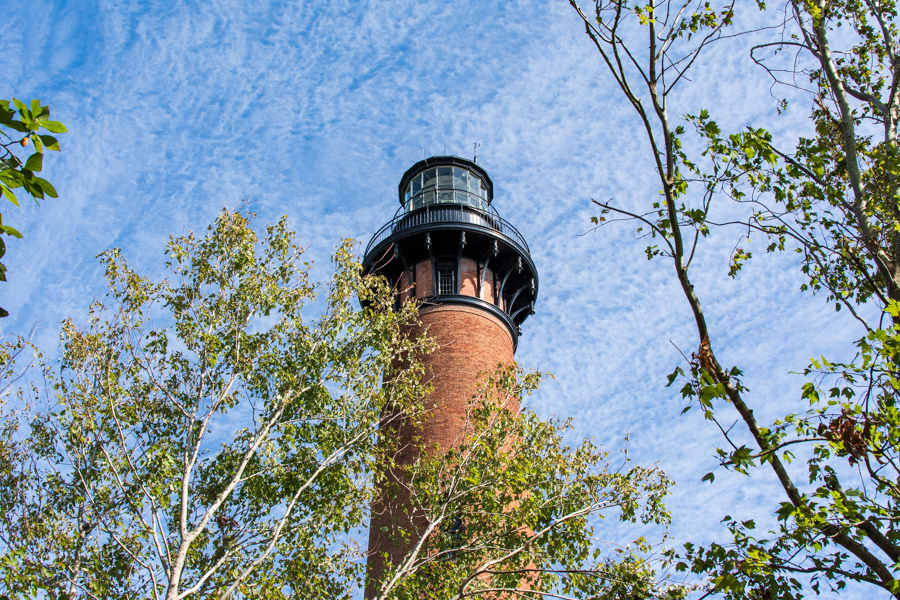 Currituck Beach Lighthouse peeks out from behind the trees.