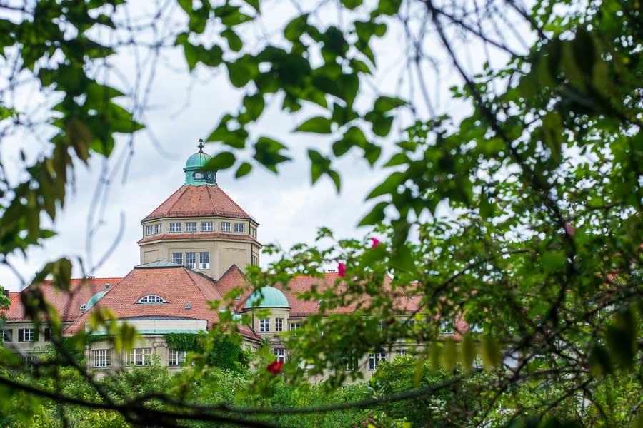The Munich Botanical Garden hall seen through the trees.