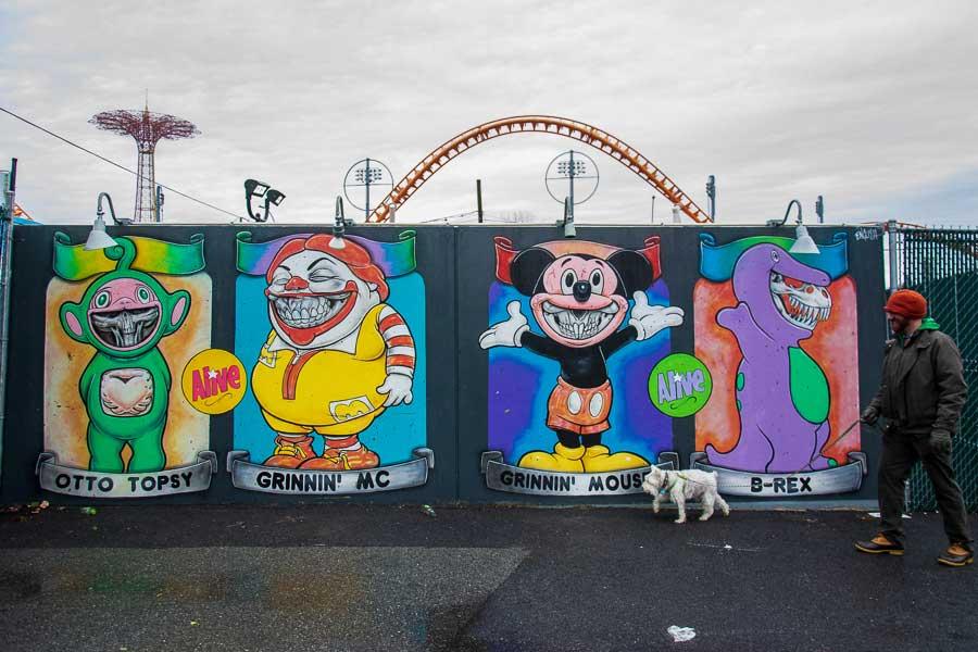 A dog exploring the Coney Island Art Walls.