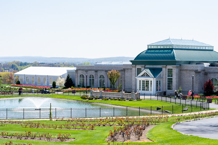The conservatory and Swan Lake welcome visitors to Hershey Gardens.