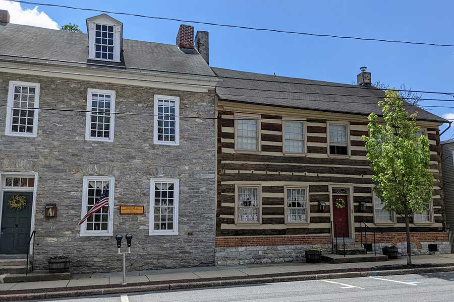 Historic stone and wooden houses line Main Street in Historic Downtown Lititz, PA.