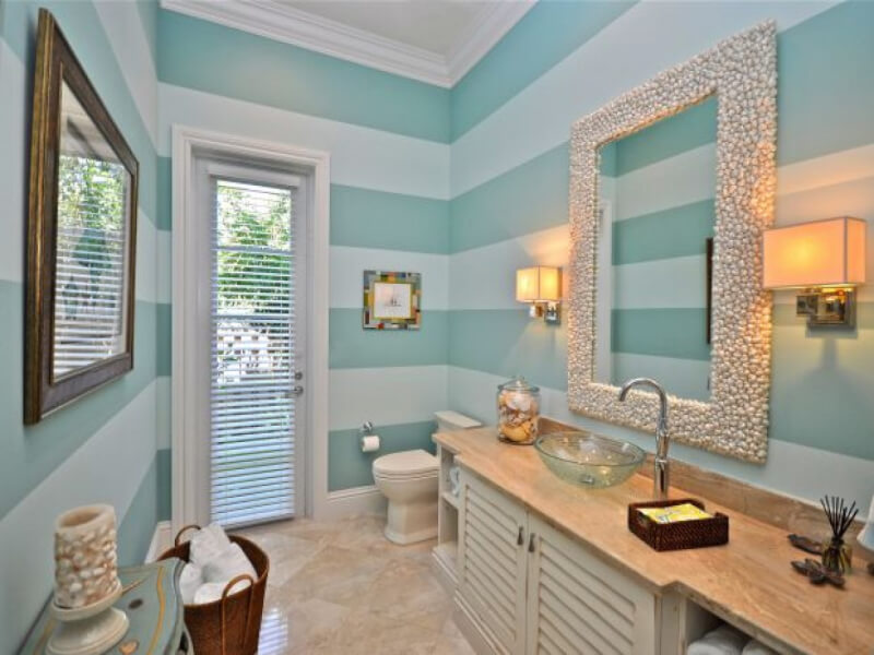 Beach Themed Bathroom With Blue Striped Wall