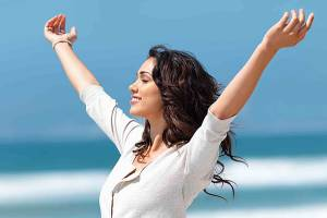 Reverse Type 2 Diabetes. The Genuine Blood Sugar Solution.  Image of woman open arms