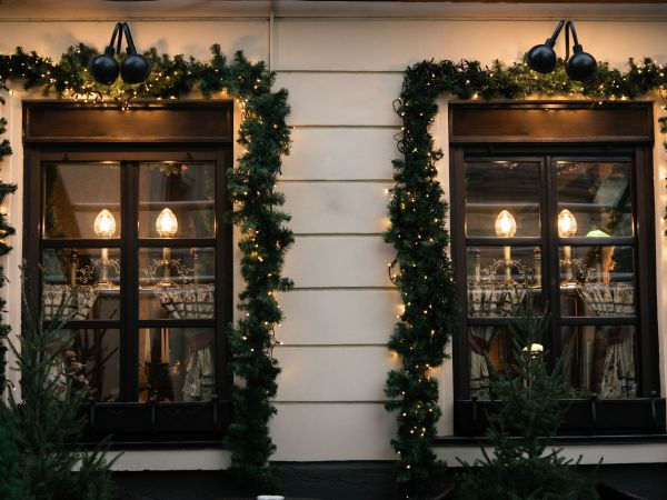 stylish luxury  christmas  vintage garland on window, celebration decoration for holidays in the city