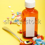 stock-photo-image-of-a-cough-syrup-with-spoon-and-some-pills-isolated-on-yellow-background-37896658