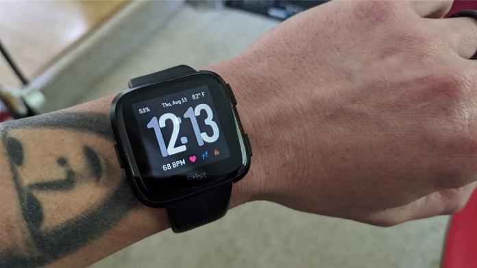 The Fitbit Versa on a man's wrist