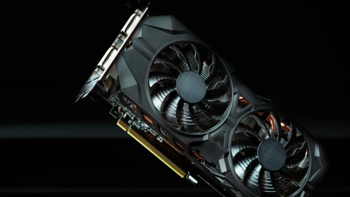 Graphics card standing against black and gray backdrop