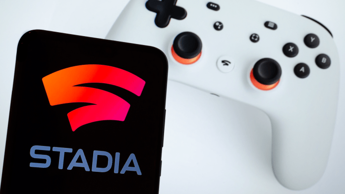 Smartphone with Stadia logo next to Stadia game controller