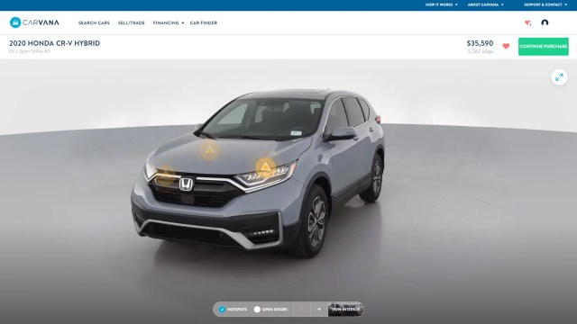 the Carvana website, featuring a CR-V Hybrid with several yellow symbols
