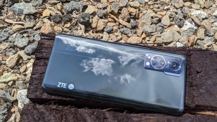 ZTE Axon 30 5G on wooden log