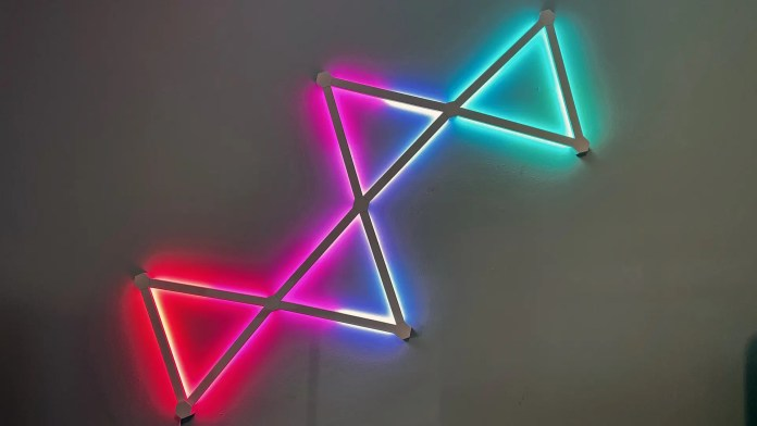 The connected bow tie lights glowing in red, purple, blue, and teal.