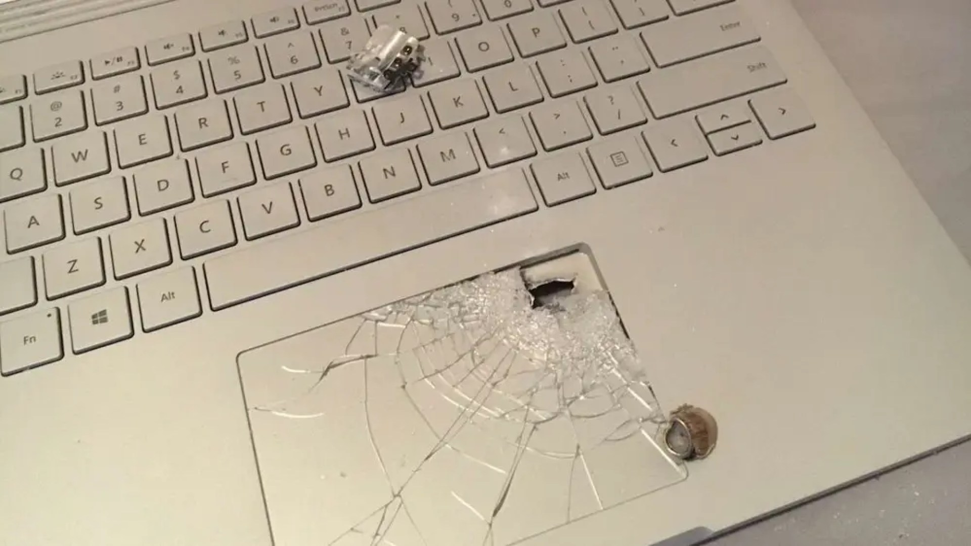 Bullet lodged in a Surface Book laptop
