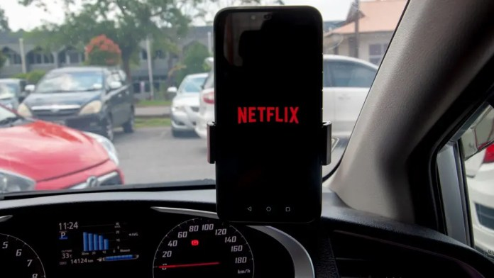 Netflix on an Android phone in a car.