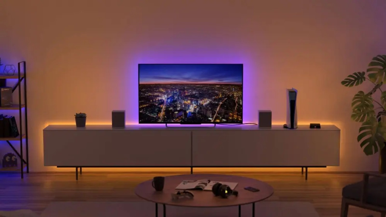 The Elgato Light Strip behind a TV and entertainment center.