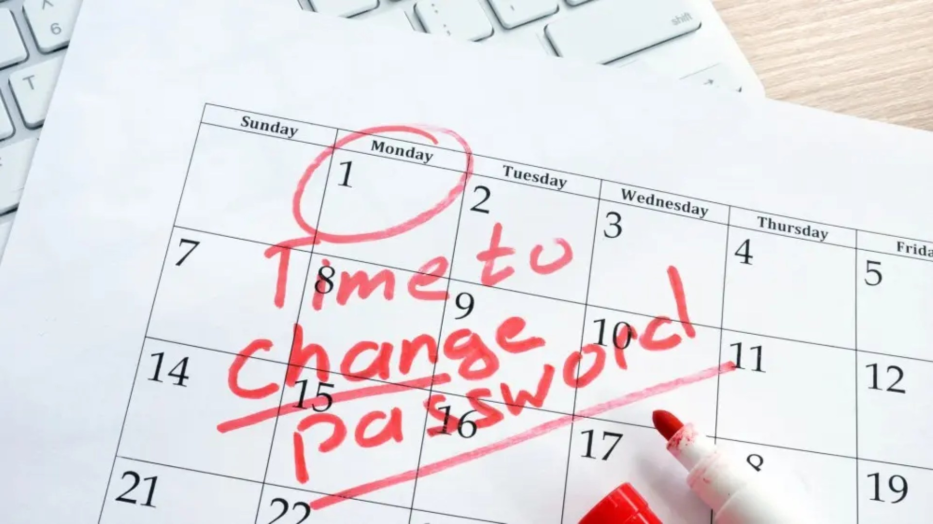 Calendar with words Time to Change Password written on it in red marker