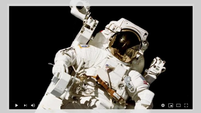 A photo of astronaut Bruce McCandles II surrounded by a YouTube video player.